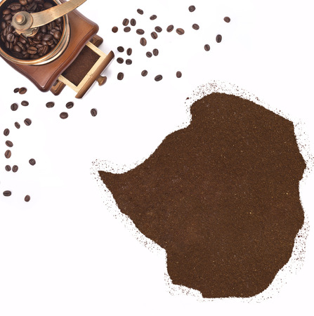 kibble: Coffee powder in the shape of Zimbabwe and a decorative coffee mill.(series)