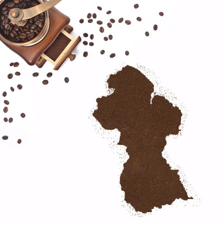 kibble: Coffee powder in the shape of Guyana and a decorative coffee mill.(series)
