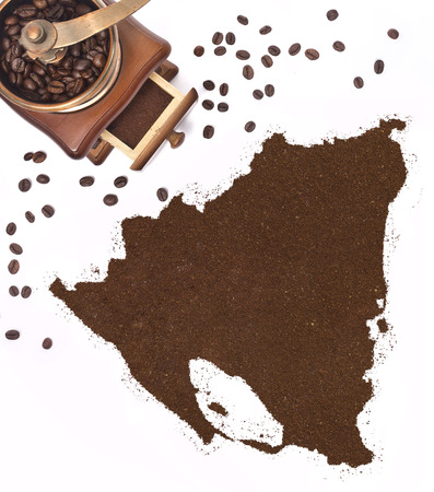 Coffee powder in the shape of Nicaragua and a decorative coffee mill.(series) photo