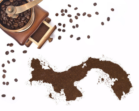 kibble: Coffee powder in the shape of Panama and a decorative coffee mill.(series) Stock Photo