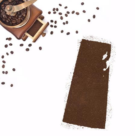 saskatchewan: Coffee powder in the shape of Saskatchewan and a decorative coffee mill.(series) Stock Photo