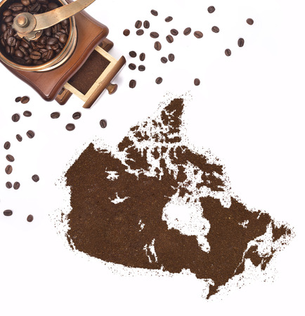 kibble: Coffee powder in the shape of Canada and a decorative coffee mill.(series)