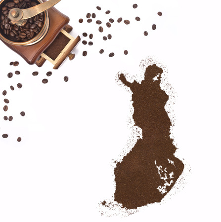 Coffee powder in the shape of Finland and a decorative coffee mill.(series) photo