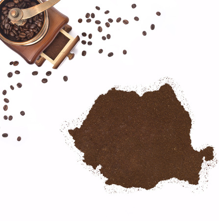 Coffee powder in the shape of Romania and a decorative coffee mill.(series) photo