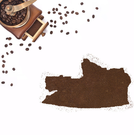 russian federation: Coffee powder in the shape of Russian Federation and a decorative coffee mill.(series) Stock Photo