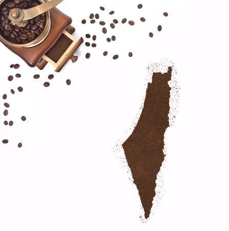 Coffee powder in the shape of Israel and a decorative coffee mill.(series) photo