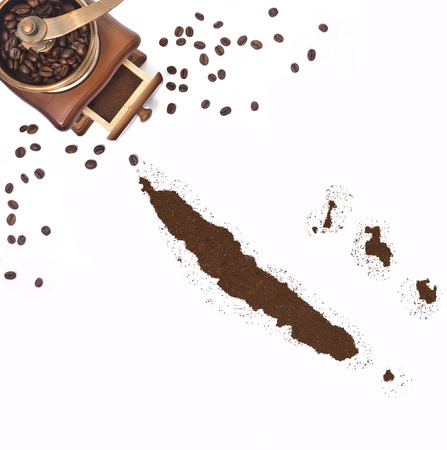 kibble: Coffee powder in the shape of New Caledonia and a decorative coffee mill.(series)
