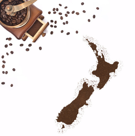 Coffee powder in the shape of New Zealand and a decorative coffee mill.(series) photo