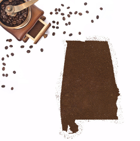 kibble: Coffee powder in the shape of Alabama and a decorative coffee mill.(series)