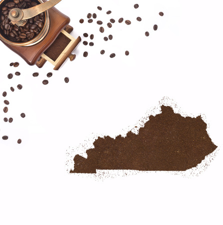 kibble: Coffee powder in the shape of Kentucky and a decorative coffee mill.(series) Stock Photo