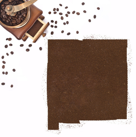 kibble: Coffee powder in the shape of New Mexico and a decorative coffee mill.(series) Stock Photo