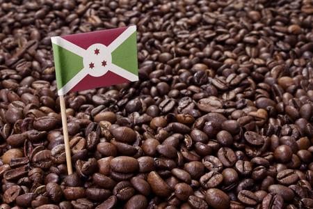 burundi: Flag of Burundi sticking in roasted coffee beans.(series) Stock Photo
