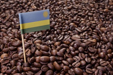 Flag of Rwanda sticking in roasted coffee beans.(series)