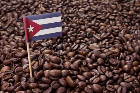 Flag of Cuba sticking in roasted coffee beans.(series)