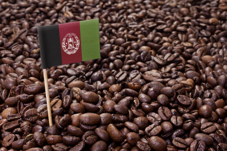 afghan flag: Flag of Afghanistan sticking in roasted coffee beans.(series) Stock Photo