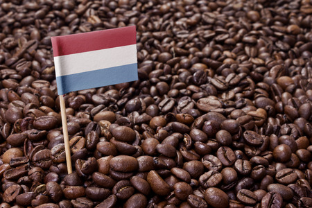Flag of Luxembourg sticking in roasted coffee beans.(series) photo