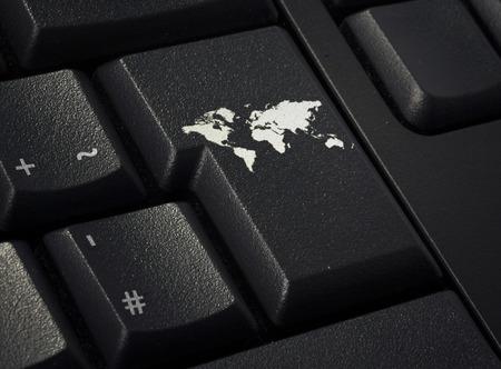 international monitoring: Return key in the shape of the world.(series) Stock Photo