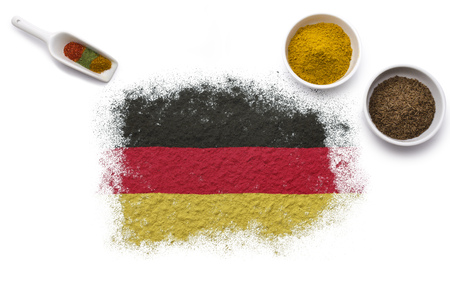 gold shovel: Various spices forming the flag of Germany.(series) Stock Photo