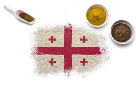 Various spices forming the flag of Georgia.(series) photo