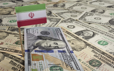 iran: Flag of Iran sticking in a variety of american banknotes.(series) Stock Photo