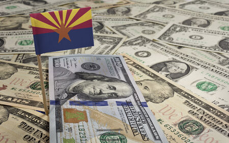 Flag of Arizona sticking in a variety of american banknotes.(series) Stock Photo