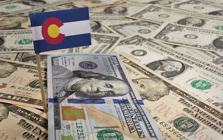 colorado flag: Flag of Colorado sticking in a variety of american banknotes.(series)