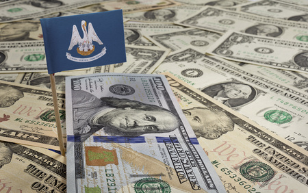 louisiana flag: Flag of Louisiana sticking in a variety of american banknotes.(series) Stock Photo