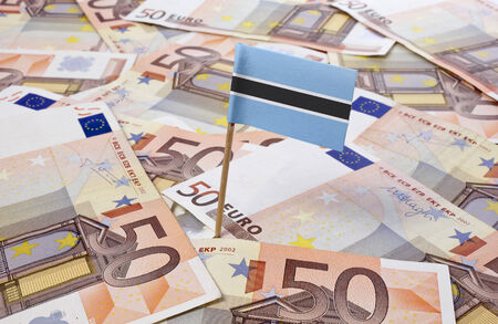 botswanan: Flag of Botswana sticking in european banknotes.(series) Stock Photo