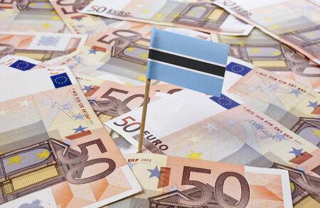 botswanan: Flag of Botswana sticking in european banknotes.(series) Stock Photo
