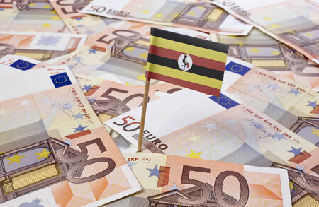 ugandan: Flag of Uganda sticking in european banknotes.(series)