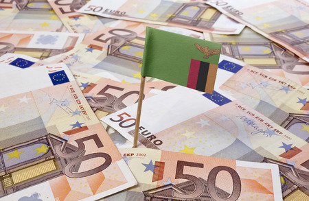 zambia: Flag of Zambia sticking in european banknotes.(series)