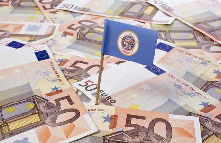 minnesota: Flag of Minnesota sticking in european banknotes.(series)