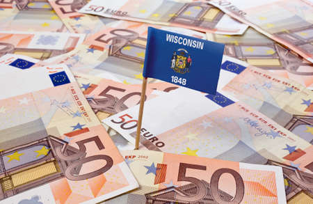 wisconsin flag: Flag of Wisconsin sticking in european banknotes.(series)