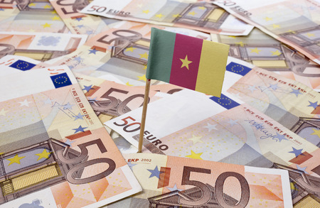 cameroon: Flag of Cameroon sticking in european banknotes.(series)