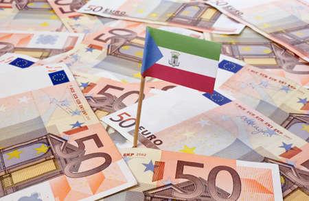 equatorial: Flag of Equatorial Guinea sticking in european banknotes.(series) Stock Photo