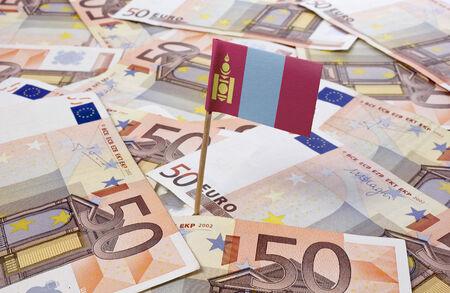 Flag of Mongolia sticking in european banknotes.(series) photo