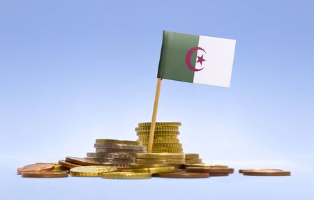 economizing: Flag of Algeria in a mixed stack of european coins and a blue background.(series)