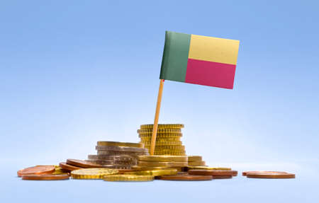 economizing: Flag of Benin in a mixed stack of european coins and a blue background.(series)