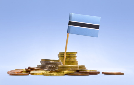 botswanan: Flag of Botswana in a mixed stack of european coins and a blue background.(series) Stock Photo