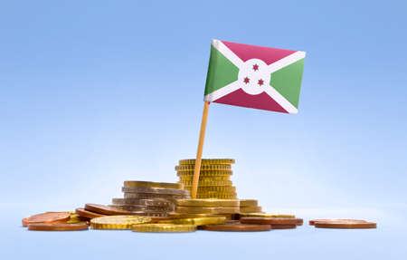 economizing: Flag of Burundi in a mixed stack of european coins and a blue background.(series)
