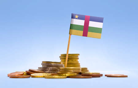 economizing: Flag of Central African Republic in a mixed stack of european coins and a blue background.(series)