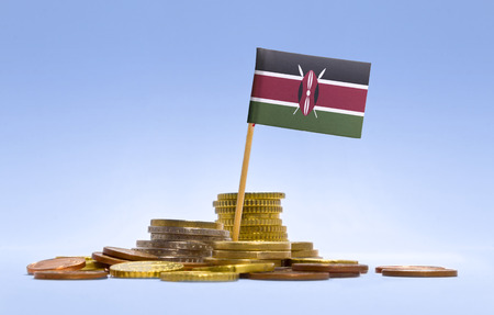 economizing: Flag of Kenya in a mixed stack of european coins and a blue background.(series)