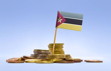 economizing: Flag of Mozambique in a mixed stack of european coins and a blue background.(series) Stock Photo