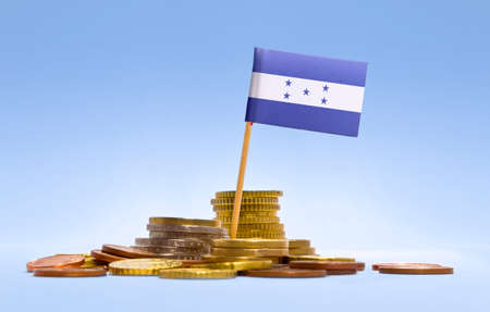 Flag of Honduras in a mixed stack of european coins and a blue background.(series) photo