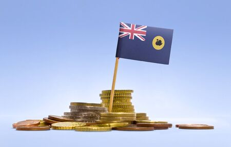 western australia: Flag of Western Australia in a mixed stack of european coins and a blue background.(series)