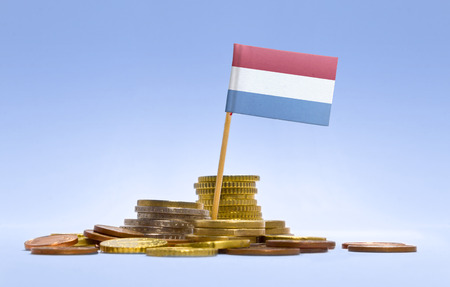 Flag of Luxembourg in a mixed stack of european coins and a blue background.(series) photo
