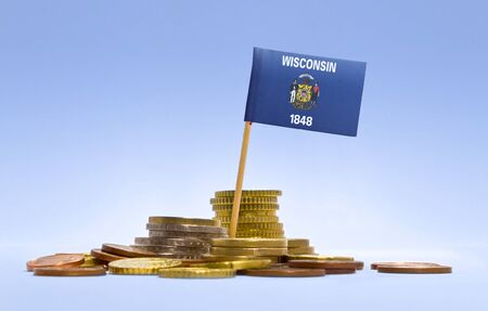 wisconsin flag: Flag of Wisconsin in a mixed stack of european coins and a blue background.(series) Stock Photo