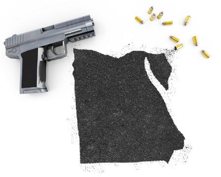 blackmail: Gunpowder forming the shape of Egypt and a handgun.(series)
