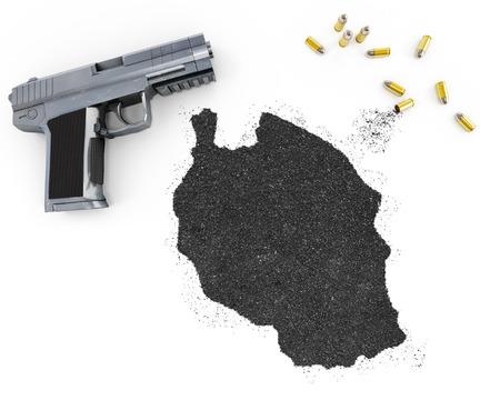 gunpowder: Gunpowder forming the shape of Tanzania and a handgun.(series) Stock Photo