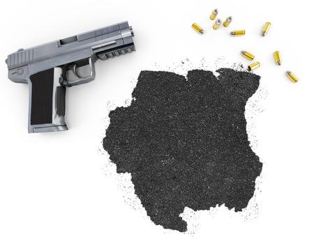 gunpowder: Gunpowder forming the shape of Suriname and a handgun.(series) Stock Photo